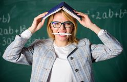 Woman teacher with book as roof on head. Memorizing method. Train memory every day. Effective method to remember. Information. Forget important information stock photos