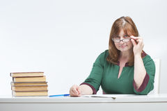 Woman teacher checks the notebook. Royalty Free Stock Photography