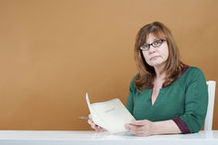 Woman teacher checks the notebook. Royalty Free Stock Images