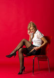 Woman teacher correcting stockings Stock Photo