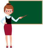 Woman teacher in full length standing at the school blackboard a Royalty Free Stock Images