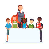 Woman teacher with group of kids holding banner Royalty Free Stock Image
