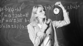 Woman teacher hold alarm clock. Girl formal wear school lecturer. Time to study. Welcome teacher school year royalty free stock photography