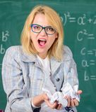 Woman teacher holds crumpled pieces of paper. Fed up of fails. Trial and error is fundamental method of problem solving. Teacher screaming face holds pieces of stock images