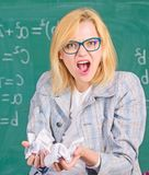 Woman teacher holds crumpled pieces of paper. Fed up of fails. Trial and error is fundamental method of problem solving. Teacher screaming face holds pieces of royalty free stock photo
