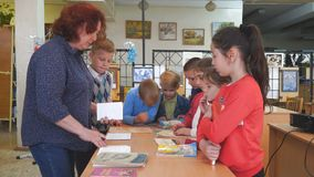 Woman Teacher with primary school students. Teacher talking to schoolchildren. Chapaevsk, Samara region, Russia - May 10, 2019: Elementary school of the city of stock video footage