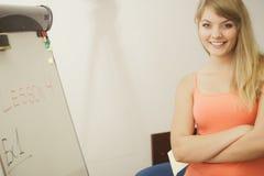 Woman teacher standing near whiteboard Stock Image
