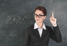 Woman teacher teaching maths Stock Image