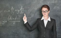 Woman teacher teaching maths Stock Photo