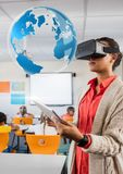 Woman teacher wearing VR Virtual Reality Headset with Interface of World Stock Image