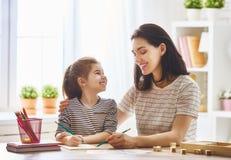Woman teaches child the alphabet Royalty Free Stock Photo