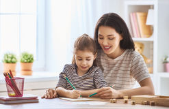 Woman teaches child the alphabet Royalty Free Stock Images