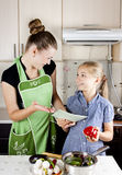 Woman teaches to cook Stock Photography