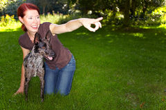 Woman teaching dog to fetch Royalty Free Stock Photo