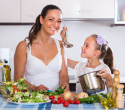 Woman teaching girl to cook Royalty Free Stock Photography
