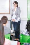 Woman teaching her high school students stock photos