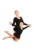 Woman teaching kid dancing. mother and daughter Royalty Free Stock Photo