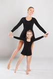 Woman teaching little girl dancing. mother and Stock Images