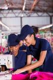 Woman teaching machinist Stock Photos