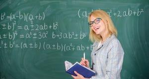 Woman teaching near chalkboard in classroom. Qualities that make good teacher. Effective teaching involve prioritizing. Knowledge and skills. Effective teaching stock photo