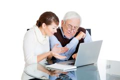 Woman teaching old man to use computer Stock Image
