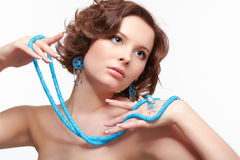Woman with teal beads Stock Images