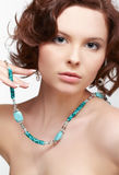 Woman with teal beads Stock Image