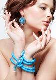 Woman with teal beads Stock Photography