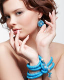 Woman with teal beads Royalty Free Stock Image
