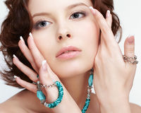 Woman with teal beads Stock Photos