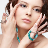 Woman with teal beads Royalty Free Stock Photography