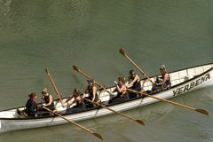 Woman team on rowing boat at Clovelly, Devon Royalty Free Stock Images
