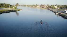 Woman team sport rowing. Woman team train the sport rowing on the river in the morning. Took from the bridge with view to south town with a lot of palms stock footage