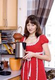 Woman with teapot Royalty Free Stock Image