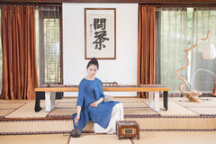 A woman with a teapot-China tea ceremony Royalty Free Stock Image