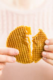 Woman tearing a dutch syrup waffle Royalty Free Stock Photography