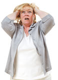 Woman tearing  hair out. Mature woman tears hear in frustration Stock Images