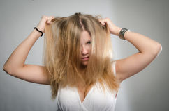 Woman tearing her hair out in frustration Royalty Free Stock Photos
