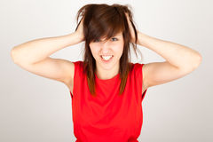 The woman is tearing her hair. The young woman is tearing her hair Stock Photos