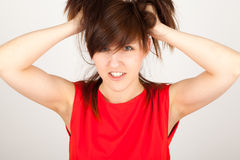 The woman is tearing her hair. The young woman is tearing her hair Royalty Free Stock Photography