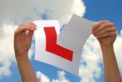 Woman tearing L Plate Stock Photography