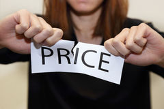 Woman tearing price banner Stock Photography
