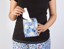 Woman tearing tissue to clean. Woman taking a tissue, wet wipe to clean Royalty Free Stock Images