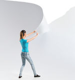 Woman tearing a white paper background Stock Images