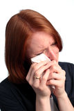Woman in Tears. A young woman wiping away her tears with a tissue Stock Photography