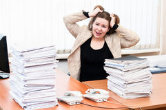 Woman tears one's hair at work Stock Images