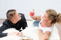 Woman teasing man with apple Royalty Free Stock Photography
