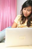 Woman and technology. Woman ausing laptop on sofe at home Stock Images