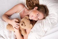 Woman with teddy Stock Photos