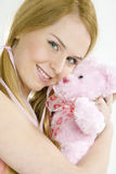 Woman with teddy bear royalty free stock image